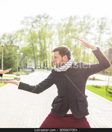 Man fool around in pose of samurai outdoors stock photo, Man fool around in pose of samurai outdoors by Satura86