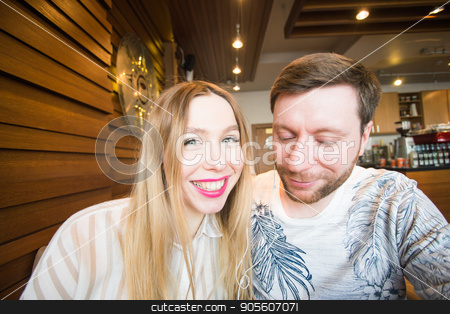 Funny playful young couple making silly face stock photo, Funny playful young couple making silly face by Satura86