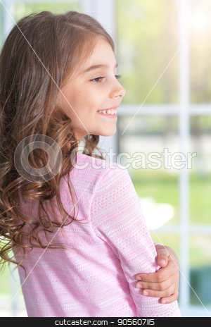 Portrait of cute little girl stock photo, Portrait of cute little girl with curly hair by Ruslan Huzau