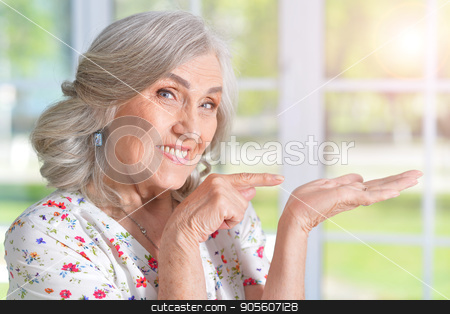 happy senior woman stock photo, Portrait of a happy senior woman close up by Ruslan Huzau