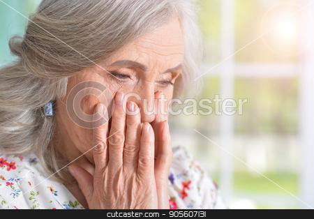 sad senior woman stock photo, Portrait of sad senior woman, close up by Ruslan Huzau