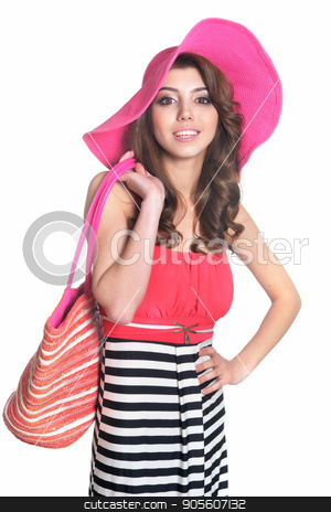 Portrait of beautiful young woman stock photo, Portrait of a beautiful brunette young woman in pink hat with beach bag isolated by Ruslan Huzau