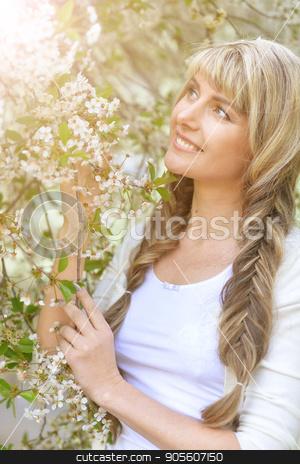Young girl in a spring garden stock photo, Beautiful young girl in a spring garden by Ruslan Huzau