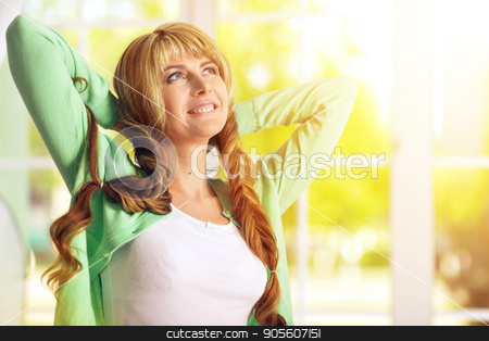 Beautiful young woman  stock photo, Beautiful young woman with pretty plaited hairstyle by Ruslan Huzau