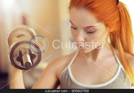 woman doing excerises with dumbbell stock photo, Sporty yougn woman doing excerises with dumbbell by Ruslan Huzau