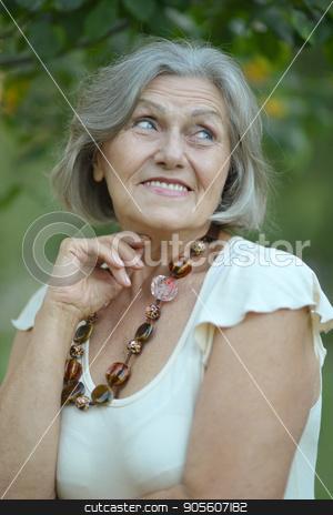 portrait of senior woman stock photo, Close up portrait of senior woman outdoors by Ruslan Huzau