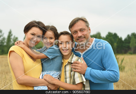 Big family resting stock photo, Portrait of a happy big family resting outdoors by Ruslan Huzau