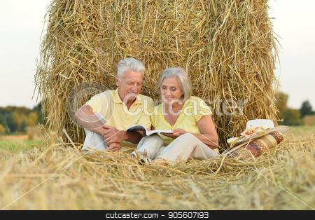 Senior couple on field of wheat  stock photo, Happy senior couple on field of wheat by Ruslan Huzau