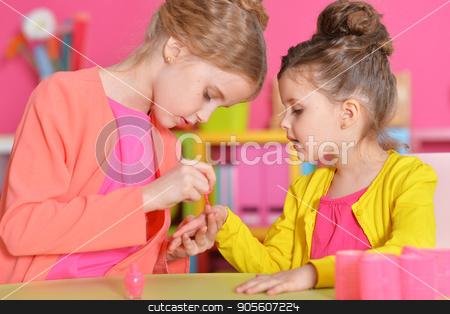 little girls doing manicure stock photo, cute little girls with stylish hairstyles doing manicure by Ruslan Huzau