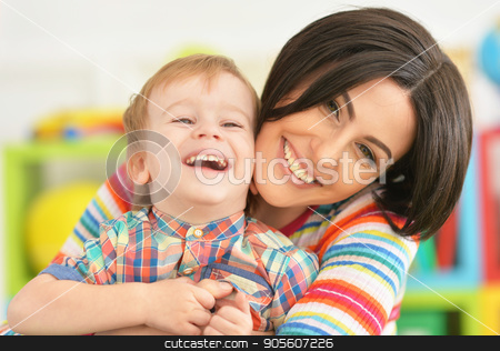 Young mother playing with son stock photo, Young mother playing with cute little son by Ruslan Huzau