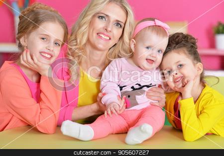 mother with three daughters stock photo, Portrait of happy mother with three adorable daughters by Ruslan Huzau