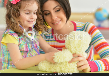 young mother playing with little daughter stock photo, Beautiful young mother playing with her cute little daughter by Ruslan Huzau