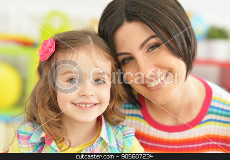 young mother with little daughter stock photo, Beautiful young mother with cute little daughter by Ruslan Huzau