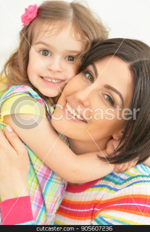 young mother hugging with little daughter stock photo, Beautiful young mother hugging with her cute little daughter by Ruslan Huzau