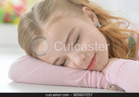 Cute little girl sleeping stock photo, Cute little girl sleeping on folded arms by Ruslan Huzau