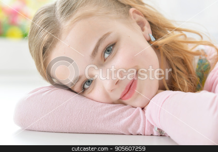 girl lying on folded arms  stock photo, Cute little girl lying on folded arms by Ruslan Huzau