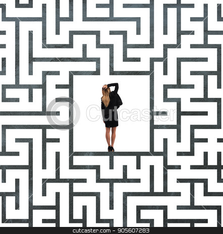 Confused businesswoman at the center of a maze stock photo, Confused businesswoman at the center of a big maze by Federico Caputo