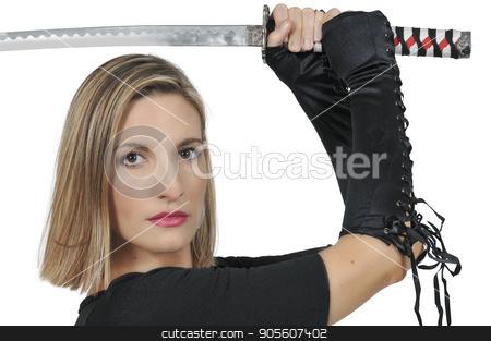 Woman Samurai Swordsman stock photo, Young woman with a samurai bushido katana sword by Robert Byron