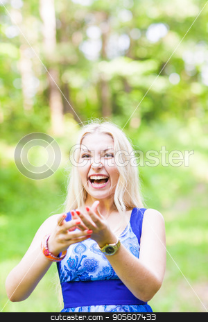 Woman playing with a butterfly stock photo, Woman playing with a butterfly in summer nature by Satura86