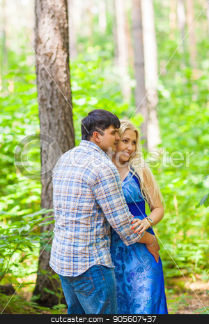 A young sweet couple in love stock photo, A young sweet couple in love on nature by Satura86