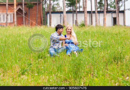 young couple sitting on grass and relaxing stock photo, young couple sitting on grass and relaxing by Satura86