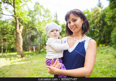 Portrait of beautiful happy smiling mother with baby outdoor stock photo, Portrait of beautiful happy smiling mother with baby outdoor by Satura86