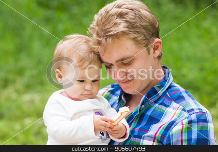 Portrait of happy father and his adorable little daughter in nature stock photo, Portrait of happy father and his adorable little daughter by Satura86