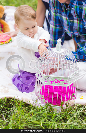 baby and mother and father playing on the green grass, family picnic stock photo, baby and mother and father playing on the green grass, family picnic by Satura86