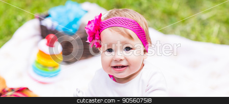 baby girl playing on the green grass, family picnic close-up stock photo, baby girl playing on the green grass, family picnic close-up by Satura86