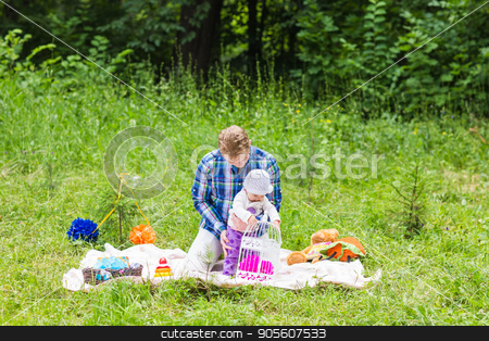 Happy father play with adorable little baby daughter in nature stock photo, Portrait of happy father and his adorable little daughter by Satura86