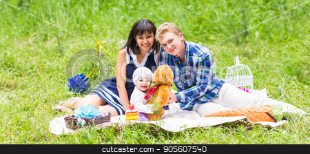 Family picnicking outdoors with their cute daughter stock photo, Family picnicking outdoors with their cute daughter by Satura86