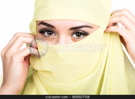 Closeup of beautiful young arabian woman in yellow hijab. Charm and beauty of the East. stock photo, Closeup of beautiful young arabian woman in yellow hijab. Charm and beauty of the East by Alexander