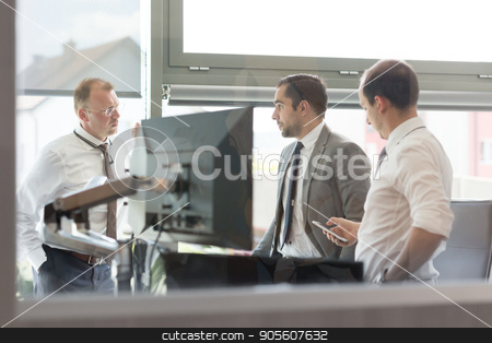 Corporate businessteam working in modern office. stock photo, Corporate business people work in modern office. Project manager team solving a problem. Business crew discussing a business issue. Businessman looking at data at mobile phone monitor. by kasto