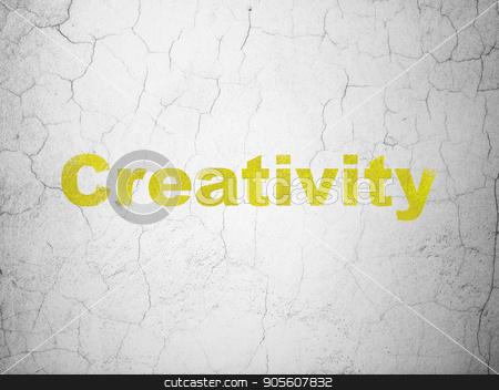 Marketing concept: Creativity on wall background stock photo, Marketing concept: Yellow Creativity on textured concrete wall background by mkabakov