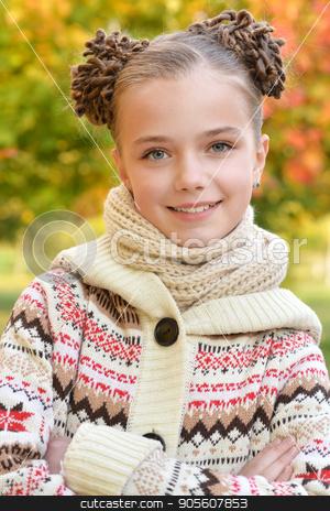 Cute little girl resting in park stock photo, Portrait of cute little girl resting in autumnal park by Ruslan Huzau
