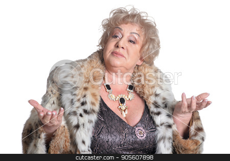Senior woman in fur shrug the hand stock photo, Senior woman in fur with necklace shruging the hand on white background by Ruslan Huzau