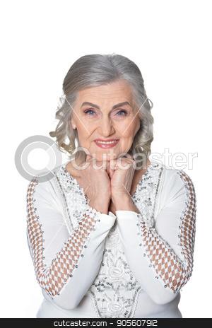 Happy senior woman stock photo, Happy senior woman smiling at the camera. Isolated on white. by Ruslan Huzau