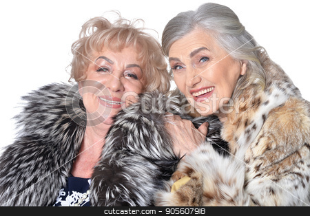 Two senior women isolate on white stock photo, Senior woman hugged another while she smiling by Ruslan Huzau