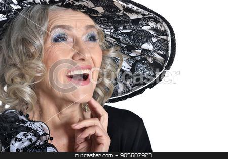 Laugh of senior woman stock photo, Senior woman in blouse smiling on white background by Ruslan Huzau