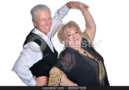 Senior couple dancing stock photo, Senior couple smiling and dancing on white background by Ruslan Huzau