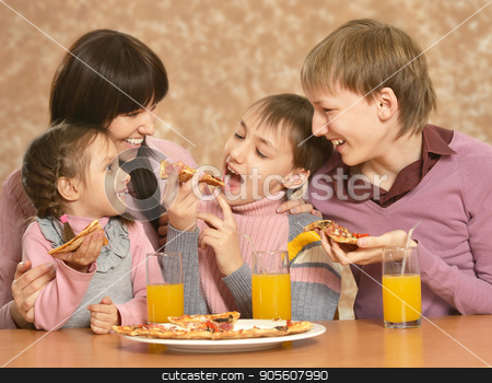 Mother with children eating pizza stock photo, Portrait of mother with children eating pizza by Ruslan Huzau