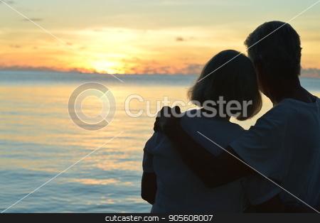 Senior couple resting near sea stock photo, Portrait of a happy senior couple resting near sea by Ruslan Huzau