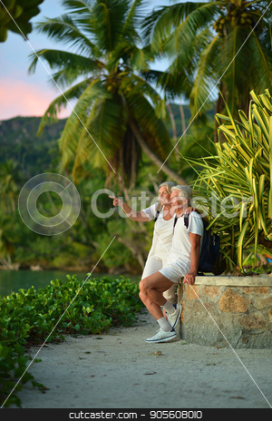 Senior couple resting outdoors stock photo, Portrait of a happy senior couple resting outdoors by Ruslan Huzau