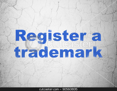 Law concept: Register A Trademark on wall background stock photo, Law concept: Blue Register A Trademark on textured concrete wall background by mkabakov