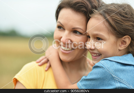 Mother with daughter on wheat field  stock photo, Mother with little daughter on wheat field by Ruslan Huzau