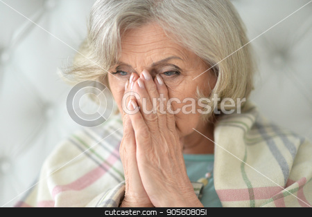 Beautiful sad elderly woman close-up stock photo, Portrait of a beautiful sad elderly woman close-up by Ruslan Huzau