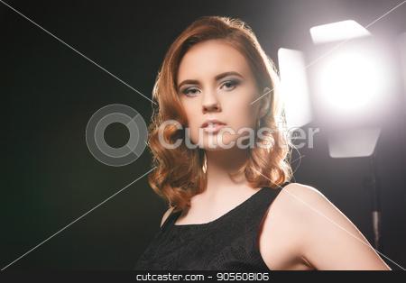 Gentle model against spotlight stock photo, Portrait of beautiful model posing in studio on background of spotlight by Isaeva Iuliia