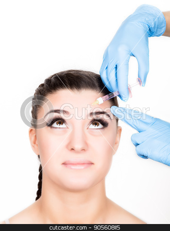 Beauty injection by doctor in blue gloves. Young woman in beauty salon stock photo, Beauty injection by doctor in blue gloves. Young woman in beauty salon. Beauty portrait. Indoor, studio by Alexander