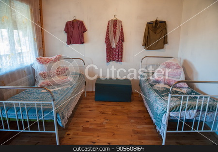 Old Slavic interior stock photo, Old Slavic interior, bedroom with two beds, male and female clothes, and old box by olinchuk