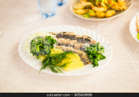 Dish with sliced fish products on the festive table stock photo, Dish with sliced fish products on the festive table by Satura86